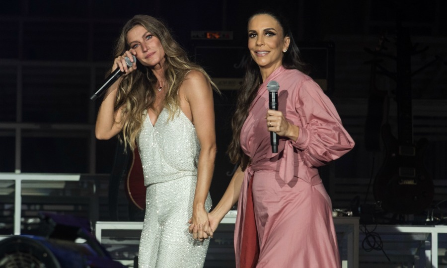 Gisele Bundchen held on to singer Ivete Sangalo after she became emotional during her performance of Imagine during the Rock in Rio festival on September 15 in Rio de Janeiro, Brazil.
