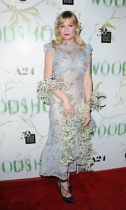 Kirsten Dunst added an interesting accessory to go with her Rodarte sheer dress and Forevermark diamonds — a boa made from flowers at the premiere of <i>Woodshock</i>.