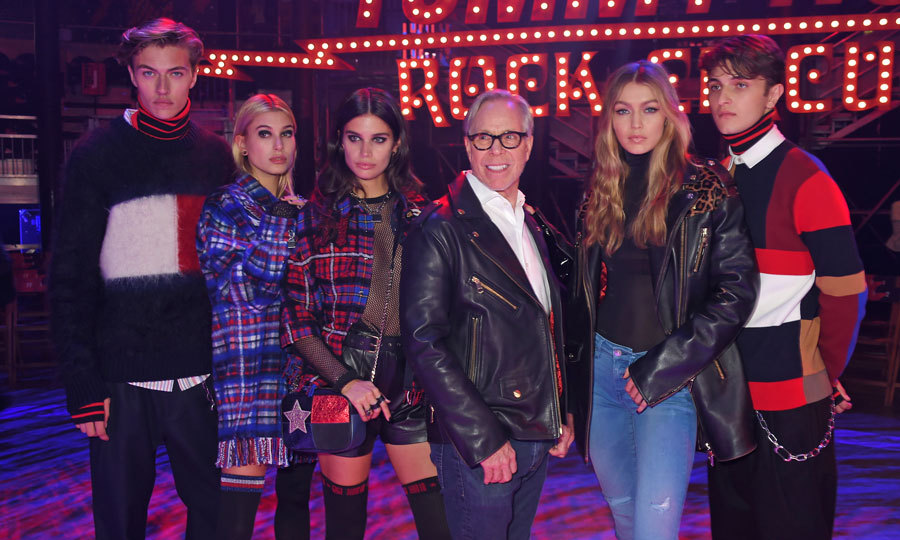Tommy Hilfiger and Gigi Hadid, who took the TOMMYNOW fashion show to London, had a fashionable assist from Lucky Blue Smith, Hailey Baldwin, Sara Sampaio and Anwar Hadid.