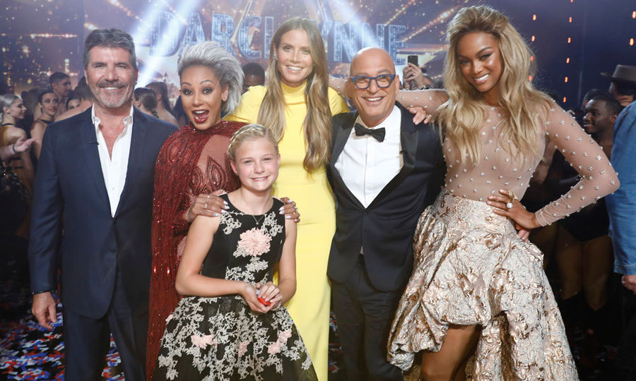 Simon Cowell, Mel B, Heidi Klum, Howie Mandel and Tyra Banks celebrated with <i>AGT</i> winner Darci Lynne Farmer, who won over voters with her ventriloquist act. The 12-year-old performer won $1 million and could headline the show's upcoming show in Las Vegas.