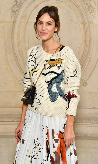Alexa Chung's a-dior-able knit at the presentation had us ready for sweater weather. 