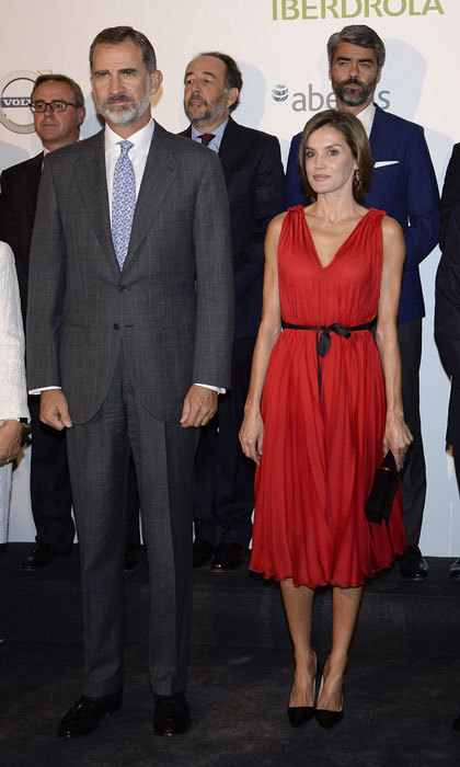 Letizia of Spain was the lady in red as she stepped out wearing a pleated Carolina Herrera dress to Vocento's 15th anniversary celebration held at Madrid's Royal Theatre. 