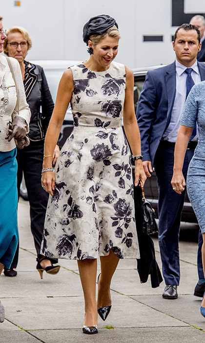 Dutch Queen Maxima stepped out in an A-line dress with purple floral print  at the World of Health Care 2017 meeting in The Hague on September 28.