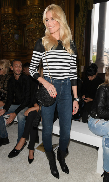 Claudia Schiffer took a seat in the Balmain front row after walking in the Versace show in Milan.