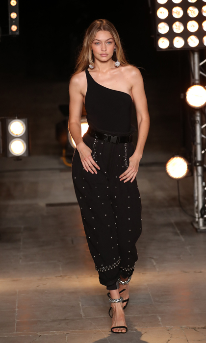 Gigi Hadid showed off her toned arms as she strutted her stuff down the runway for Isabel Marant.
