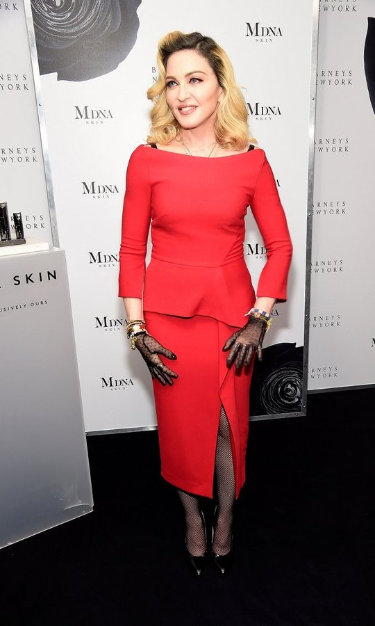 The singer channeled retro glam in a red peplum dress and lace gloves at the MDNA SKIN launch at Barneys.