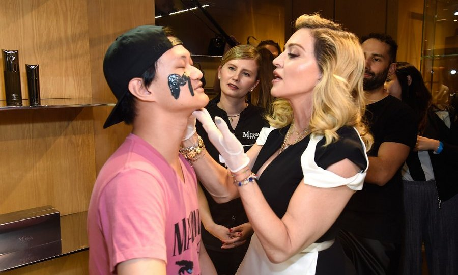 At Barneys New York in NYC, Madonna stepped into the role of facialist as she unveiled her MDNA SKIN collection.