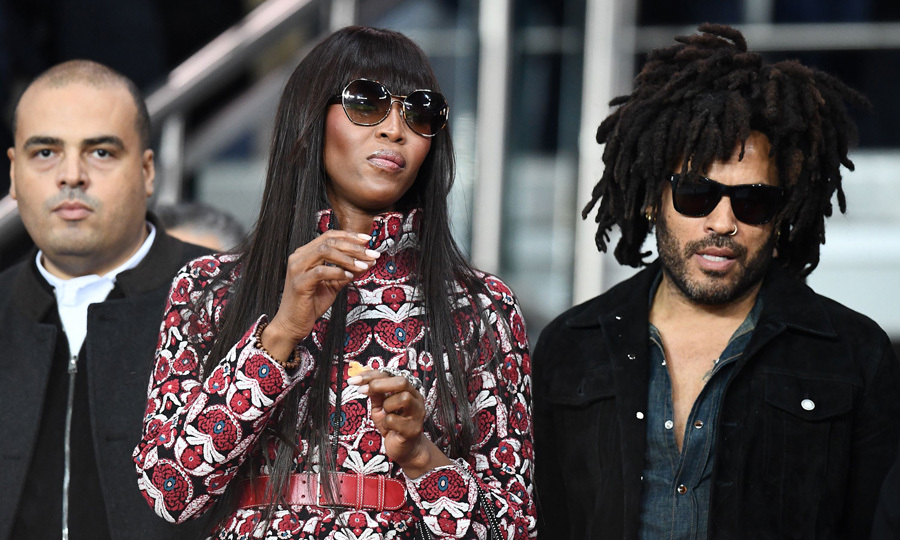 Naomi Campbell took a break from the fashion shows to attend the UEFA Champions League football match between Paris Saint-Germain and Bayern Munich with her <i>Star</i> co-star Lenny Kravitz.