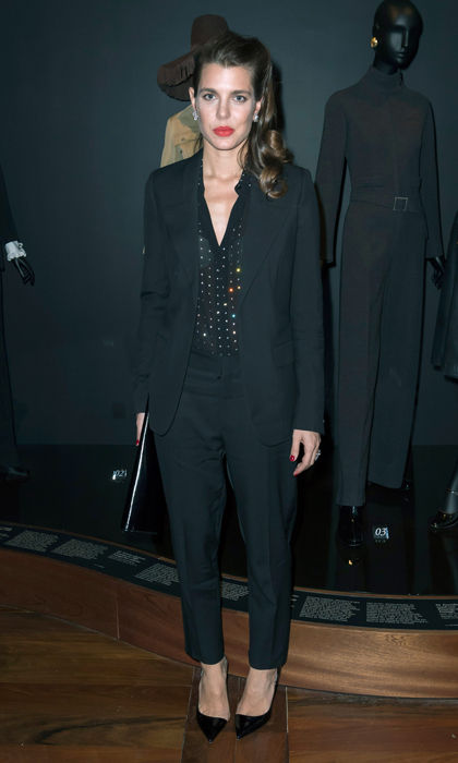 Charlotte Casiraghi kept her look simple in a black suit for the opening of the Yves Saint Laurent Museum opening party. 