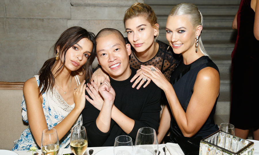 Emily Ratajkowski, Hailey Baldwin and Karlie Kloss huddled close to the man of the hour at the Atelier Swarovski by Jason Wu in Paris.