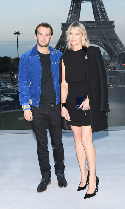 Robin Wright and her son Hopper Penn had the perfect backdrop for the Saint Laurent show - the Eiffel Tower.