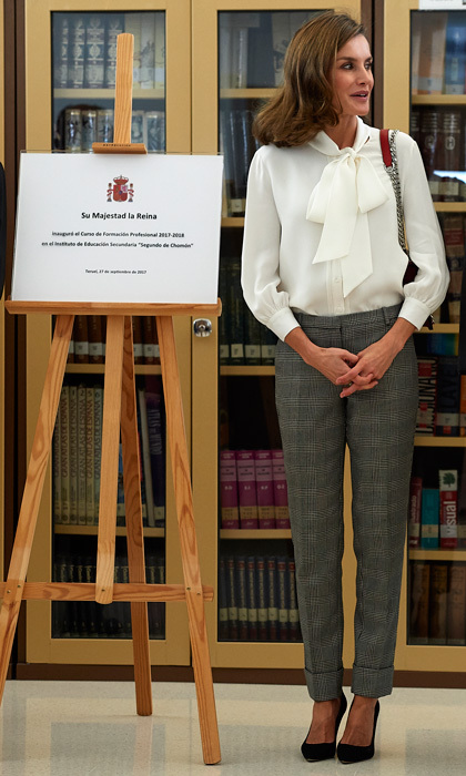 Queen Letizia went business casual in Mango pants and a Boss silk blouse and Zara bag for the opening of vocational training course at the Segundo de Chomon Secondary School in Teruel, Spain.