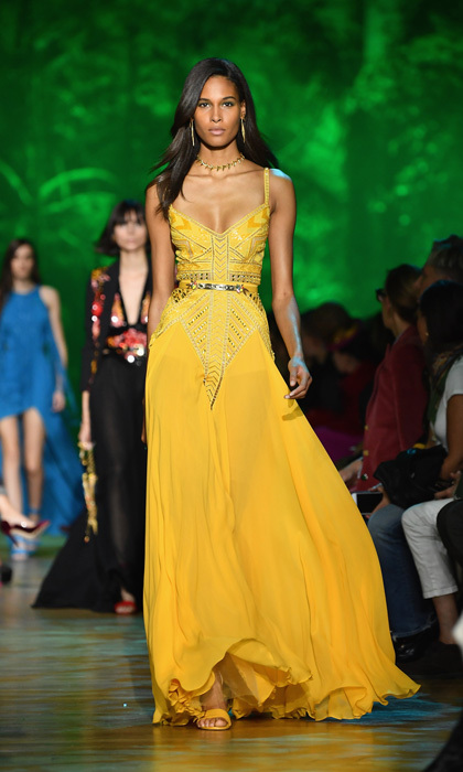 Cindy Bruna wore a flowy yellow dress down the Elie Saab runway.