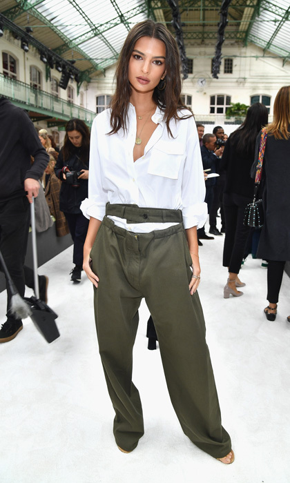 Emily Ratajkowski opted for an oversized jumpsuit as she sat front row at Valentino.