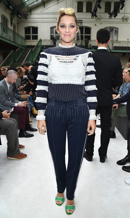 Marion Cotillard wore a navy and white ensemble paired with green heels to the Valentino show.