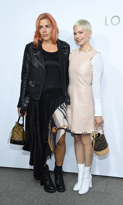 Michelle Williams had her best friend, Busy Philipps, by her side at the opening of the Louis Vuitton boutique during Paris Fashion Week.