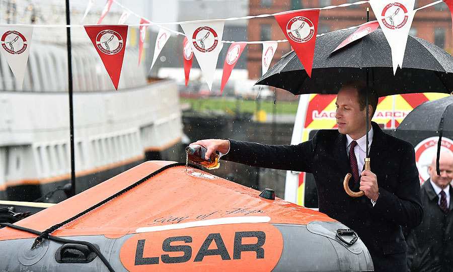 "On day one of his trip to Belfast, Northern Ireland, <a href=""http://us.hellomagazine.com/tags/1/monaco-royals/"">Prince William</a> was tasked with naming a new lifeboat. The British royal poured a measure of whiskey onto <I>Ray of Hope</I> during the ceremony while visiting the headquarters of the Lagan Search and Rescue service, who patrol the waters of the River Lagan.