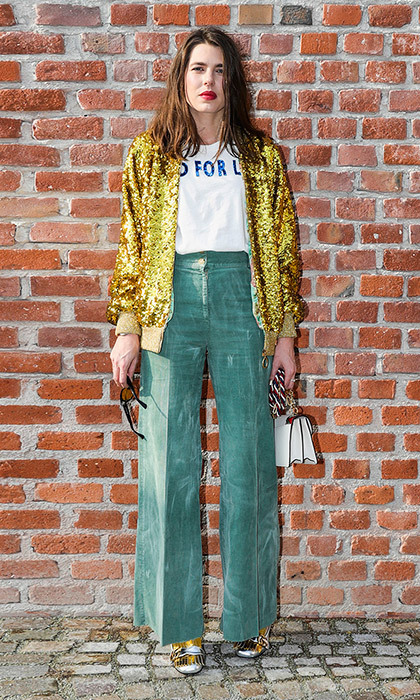 Princess Grace's granddaughter gave her outfit an edge for Gucci's Milan Fashion Week Fall/Winter 2017/18 show. We love the combination of the sequin jacket, metallic loafers, high-waisted green trousers and pop of red lipstick.
