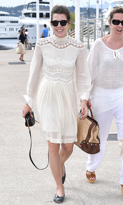 A Gucci little white dress and ballet flats for day six of the 70th Annual Cannes Film Festival in May 2017.