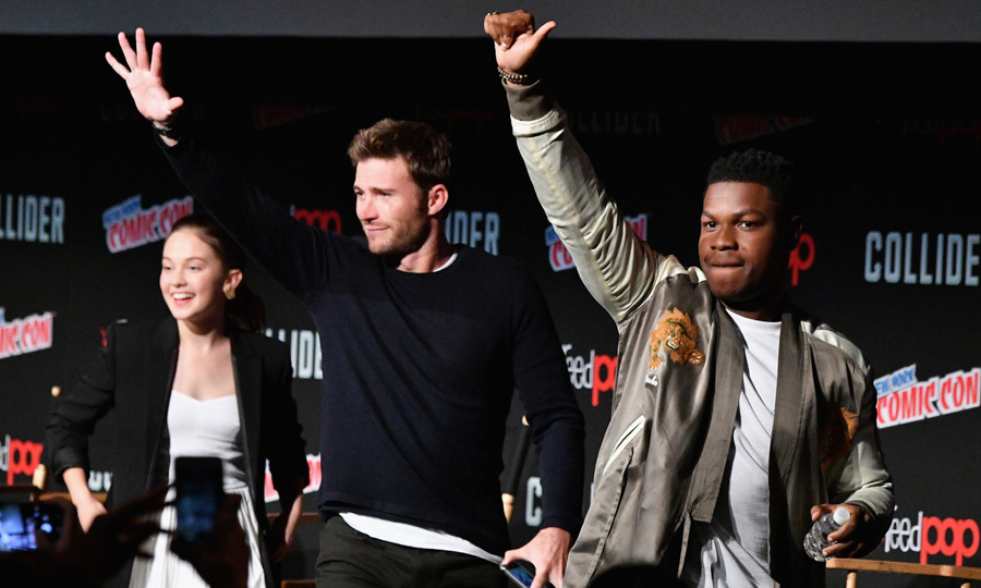 Scott Eastwood (left) and John Boyega (right) waved to fans while on stage at a panel for their upcoming movie <i>Pacific Rim: Uprising</i> during New York Comic Con on October 6.