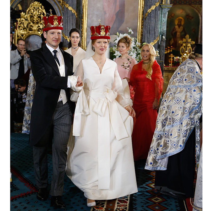 It was time for a royal wedding in Belgrade as Prince Philip of Serbia tied the knot with his love Danica Marinkovic at the Cathedral Church of St. Michael the Archangel on October 7. Danica was the picture of happiness in a full-length silk princess gown that featured billowy sheer long sleeves, an oversized bow sash at the waist and a sweeping train. 