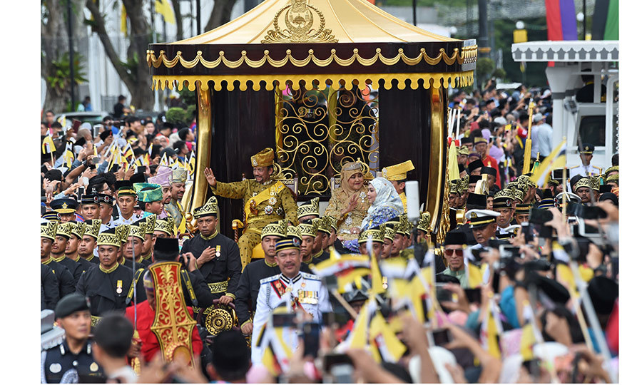 The Sultan of Brunei and Queen Saleha waved to crowds from their royal chariot during a procession to celebrate the Sultan's Golden Jubilee. The wealthiest monarch in the world celebrated 50 years on the throne with a host of lavish celebrations attended by international royals including Prince Edward and Sophie, Countess of Wessex from the UK. 
