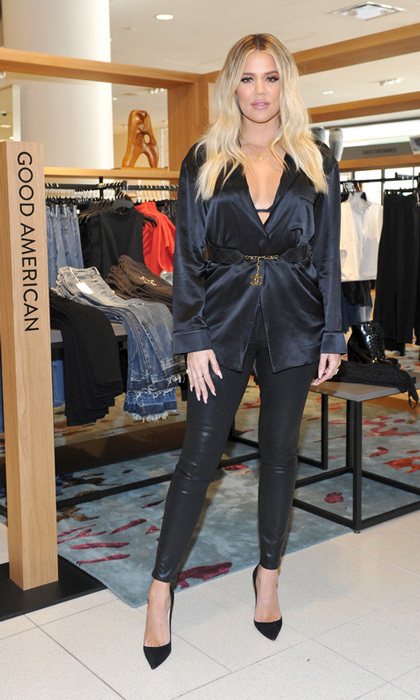 Khloe Kardashian made her first public appearance since the pregnancy news hit on October 7. The Good American fashion founder visited Nordstrom in Century City to promote the line's latest collection. For the outing, she paired a satin low-cut shirt with black pants and pumps. 