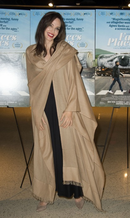 Angelina Jolie looked equally elegant at the premiere, concealing a simple black dress underneath an oversized camel-colored pashmina.