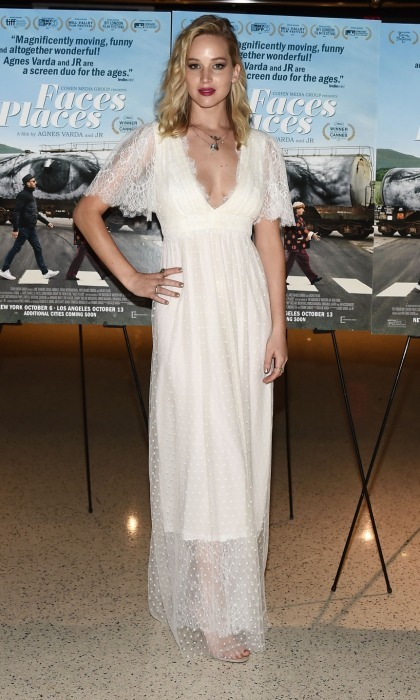 Jennifer Lawrence made an ethereally bold fashion statement at the <i>Faces Places</i> premiere in West Hollywood on October 11. The 27-year-old opted to wear an actual wedding dress! The L. Wells Bridal gown featured a plunging neckline and flowing lace sleeves, complimenting the star's undone locks nicely.