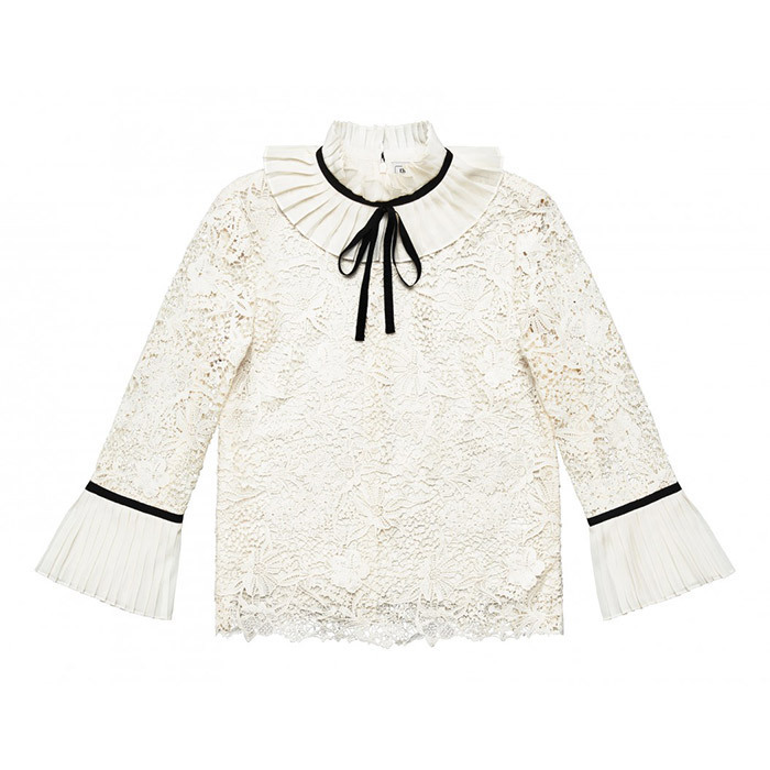 This modest white blouse with black ribbon detail and bracelet sleeves would look right at home at the palace, but is versatile enough that it can be paired with a number of pieces, from a ladylike skirt to distressed jeans.