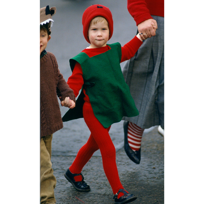 His Royal Cuteness! Princess Diana's youngest son, Prince Harry, adorably dressed up in a red goblin costume for his nursery school's nativity play in 1987.