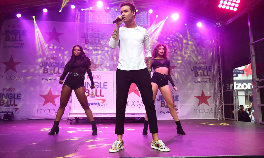 Yeah, yeah, yeah, yeah! Liam Payne came back to the states to perform onstage during Z100's Jingle Ball kick off presented by Capital One at Macy's Herald Square in NYC. The former One Direction member performed his solo single Strip That Down and hit with Zedd Get Low.