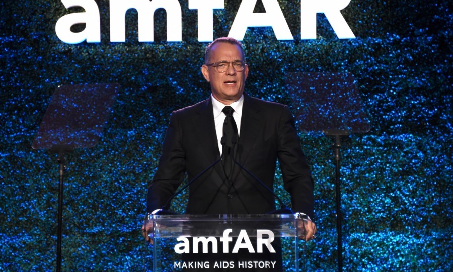 "Tom Hanks, who has twice starred alongside Julia, presented his pal with the with amfAR's ""Award of Courage"" in recognition of her support of the fight against AIDS. 