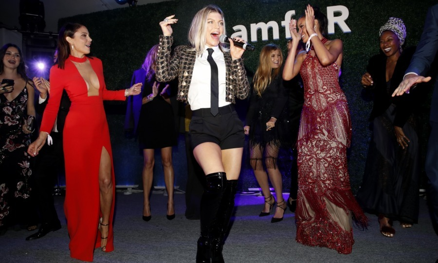 Dressed in shorts and over-the-knee boots, singer Fergie got stars like Bethenny Frankel, Selita Ebanks and Connie Britton groovin' at the amfAR event. 