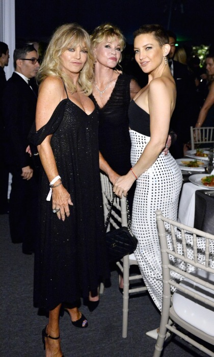Mother-daughter actresses Goldie Hawn and Kate Hudson struck a pose with good friend Melanie Griffith, center, at the fundraiser.