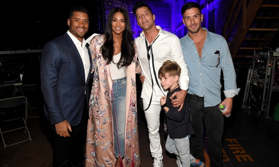 Backstage power couples! Ciara and her NFL hubby Russell Wilson posed with Ricky Martin, his fiancé Jwan Yosef and their son while taking a break from manning the phone lines.