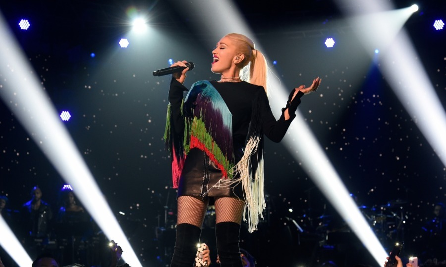 Rocking a colorful fringe number, Gwen Stefani put her talent on display to round up funds. The singer performed her song Underneath It All.