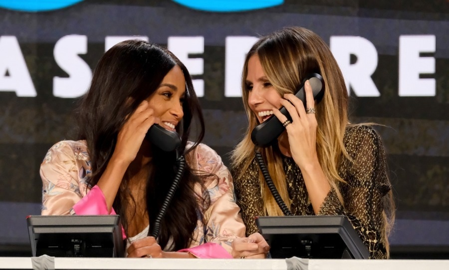 We got this! Ciara and Heidi Klum shared a sweet moment while taking calls.