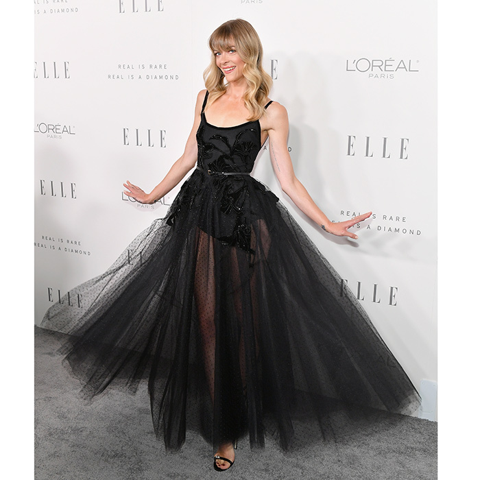 Jamie King took a spin on the ELLE grey carpet in a dramatic black Elie Saab gown featuring a transparent chiffon skirt.