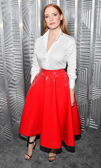 Jessica Chastain put a spin on a 1950s silhouette, looking like a modern Hitchcock heroine. The Calvin Klein look featured a waist-defining red rubber skirt with a traditional tailored white blouse.