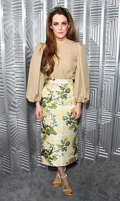 Also at the Women in Hollywood party, Elvis Presley's actress granddaughter Riley Keough served up fairytale heroine with an edge in a Calvin Klein floral pencil skirt and billowy-sleeved beige blouse. A sweet green ribbon in her hair and yellow sandals completed the look.