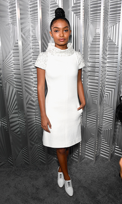 <I>Black-ish</I> actress Yara Shahidi showed her budding style star credentials in flawless Chanel at the 24th Annual Women in Hollywood Celebration at the Four Seasons Hotel Los Angeles. Lace-up oxfords and a chic top knot hairstyle finished off the look.