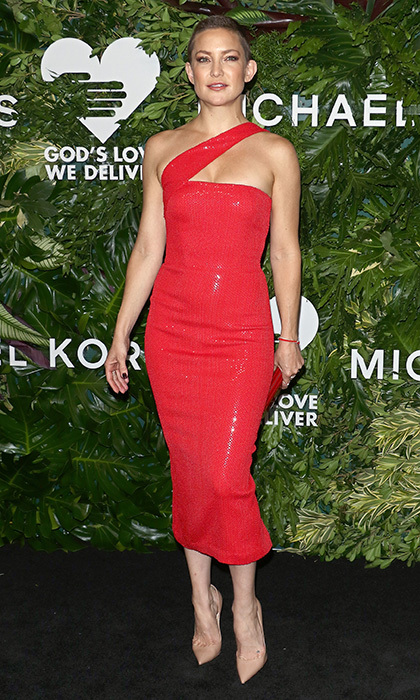 Kate Hudson rocked her cool cropped hairstyle with a sexy red one-shouldered midi dress by Michael Kors at the God's Love We Deliver gala. She finished off the outfit with a red clutch and nude high heels.