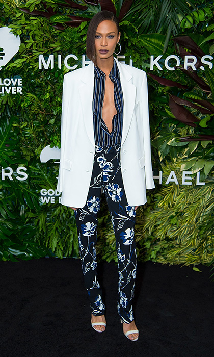 Putting a spin on the trouser suit at the Golden Heart Awards, supermodel Joan Smalls wore this Resort 2018 Michael Kors ensemble with floral trousers, a striped menswear-look shirt and white blazer thrown over her shoulders. 