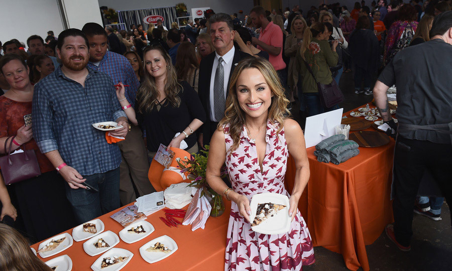 Dig in! Everday Italian star Giada De Laurentiis was all smiles as she posed with fans during the Food Network & Cooking Channel New York City Wine & Food Festival presented by Rana and Cauli'Flour on October 14.