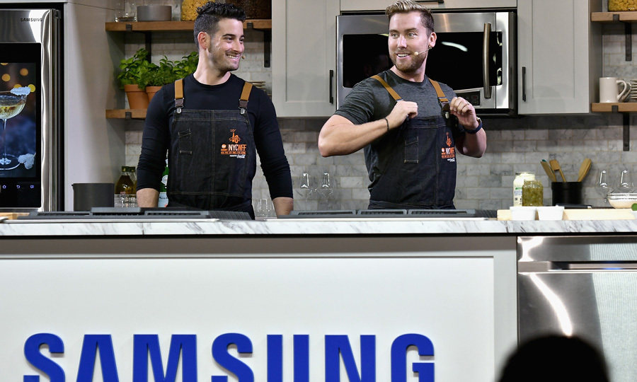 Lance Bass and his husband Michael Turchin got busy cooking in the kitchen during their Samsung Culinary Demonstration presented by MasterCard during the Food Network & Cooking Channel New York City Wine & Food Festival.