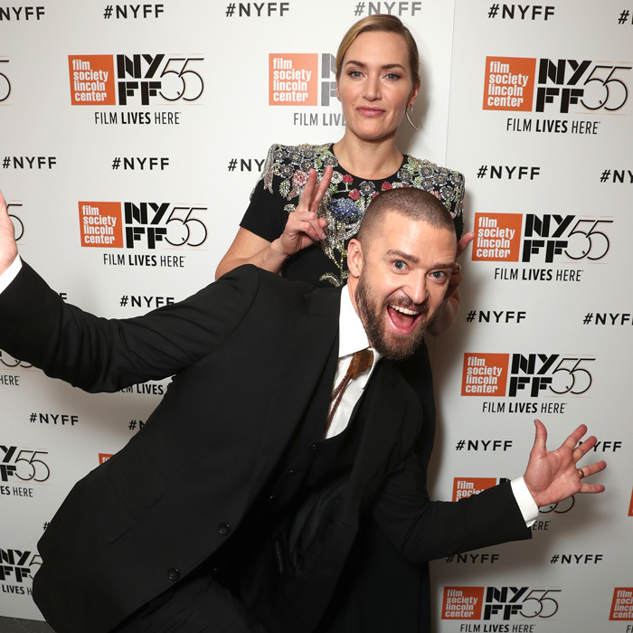 Justin Timberlake and Kate Winslet had some fun on the red carpet during the premiere of <i>Wonder Wheel</i> during the New York Film Festival on October 14. Justin looked dapper in a black suit by Tom Ford while Kate dazzled in Alexander McQueen.