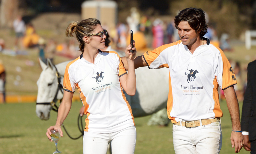 "A couple that plays together, stays together! Delfina Blaquier snapped a photo of her husband Nacho Figueras during the eighth annual Veuve Cliquot Polo Classic in Pacific Palisades. After the match, the veteran polo player took to his Instagram to thank all the attendees writing, ""Thank you everyone for coming and supporting this great event. Thank you to @veuveclicquot for being the best partner and for the many people that work to make this a wonderful experience. #VCPoloClassic #willrogers#losangeles.""