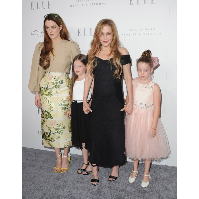 Lisa Marie Presley made a rare appearance with her three look-alike daughters — Riley Keough and nine-year-old twins Finley and Harper — at the 24th annual Elle Women in Hollywood Celebration in L.A. on October 16.