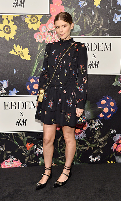 Kate Mara showed off a sweet, leggy look in a high-necked, long-sleeved midi dress at the launch. A metallic purse and flats completed the fab floral ensemble.